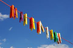 pegs in the sky - stock photo