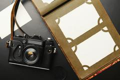 Old vintage camera with album and blank pictures Stock Photos