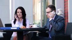 Business people talking on cellphone in cafe HD Stock Footage