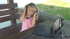 Child Playing, Listening Music on Ipad, Tablet, Girl with Headphones, Children - stock footage