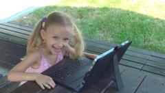 Happy Child Dancing while Using Tablet in Park, Smiling Girl Playing Outdoor Stock Footage