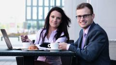 Successful happy young business people in cafe HD - stock footage
