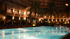 The swimming pool at luxury hotel in night illumination, Ajman, UAE Stock Footage