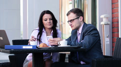 Businessman and businesswoman with smarphone in cafe HD Stock Footage