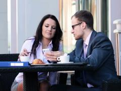 Businessman and businesswoman with smarphone in cafe NTSC Stock Footage