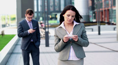 Beautiful businesswoman using smarphone in the city HD Stock Footage