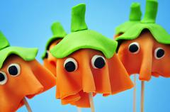 cake pops with the shape of ghost halloween pumpkins - stock photo