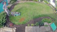 Stock Video Footage of Young man cuts the grass in the yard. Time-lapse shot