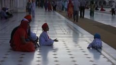 Children playing at the golden temple Stock Footage