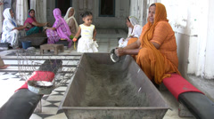 Woman washes the dishes at the Golden Temple Stock Footage