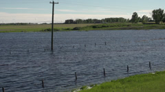 Flooding, road and field submerged Stock Footage