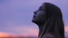 Girl Looking Up Sunset Sky Hope, Saying Prayer HD - stock footage