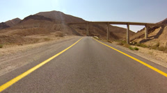 Desert road crossing the BIg Crater in the Negev,  Israel Stock Footage