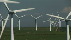 Wind turbines and grass - stock footage