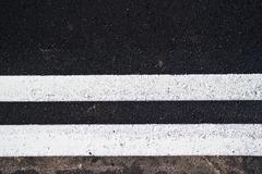 Kaksinkertainen linjat tiellä Kuvituskuvat