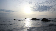 Stock Video Footage of rocks in ocean at sunrise