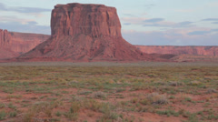 Monument Valley pan right Mitchell Mesa in the late afternoon Stock Footage