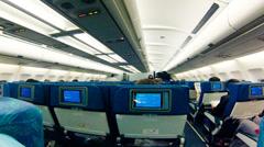 Passengers board interior of modern airplane Stock Footage