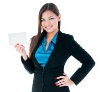 Cute businesswoman holding blank card - stock photo