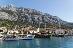 Makarska port, with biokovo mountain, croatia Stock Photos