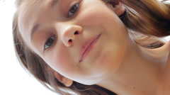 Beautiful Face Young Girl Smiling Close Up From Below HD Stock Footage