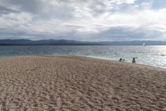 croatia´s most famous beach the golden horn (zlatni rat) near bol on the isl - stock photo