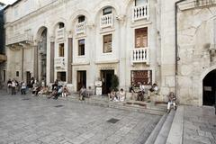 people sitting in cafe, diocletian s palace, split, central dalmatia, croatia - stock photo