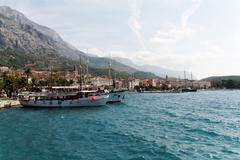 Stock Photo of makarska port, with biokovo mountain, croatia