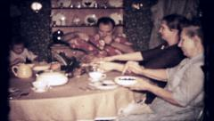 416 - cut turkey & pass dishes on Thanksgiving day - vintage film home movie Stock Footage