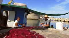 Fishermen pulling up fishing nets Stock Footage