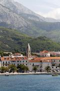 Stock Photo of makarska with biokovo mountain from ferry boat, croatia