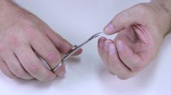 Man cutting his fingernails - stock footage