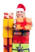 Happy christmas woman giving present Stock Photos