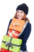 Stock Photo of happy woman with many presents