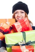 smiling woman with many presents - stock photo