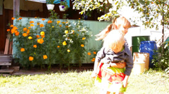 Two girls playing, laughing Stock Footage