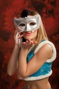 Stock Photo of cute snow maiden in silver mask