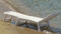 Deck chair isolated on shore Stock Footage