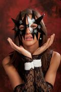 Black star mask Stock Photos