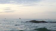 Fishing boat sailing across horizon Stock Footage
