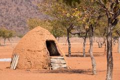 Traditional huts of himba people Stock Photos