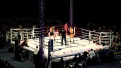 Kickbox fighters exchanged blows in the ring - stock footage