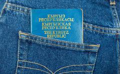 kyrgyz  republic passport in the back jeans pocket - stock photo