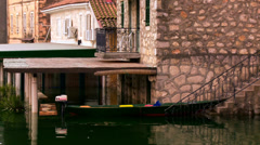 Moored boat on the threshold of the house in flooded area Stock Footage