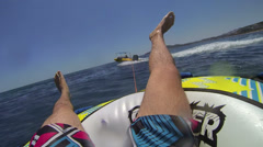 Tube riding behind the boat on Rodos Stock Footage