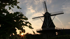 Dutch windmill at dusk, slider shot - stock footage