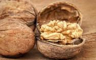 Stock Photo of walnuts on old wooden background