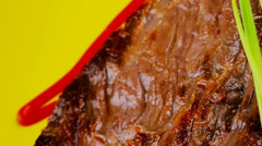 Stock Video Footage of meat food : roasted fillet mignon on green plate with chives