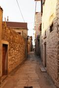 narrow street, sibenik, croatia - stock photo
