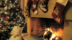A burning fireplace decorated with Christmas stockings - stock footage
